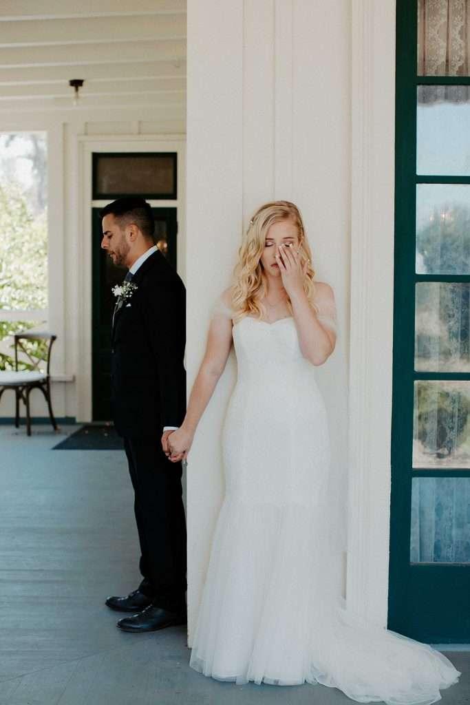 brides cries during first prayer first look